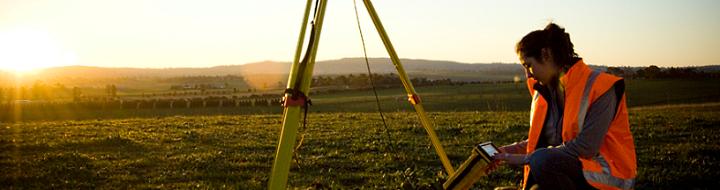 Land surveyor in rural area