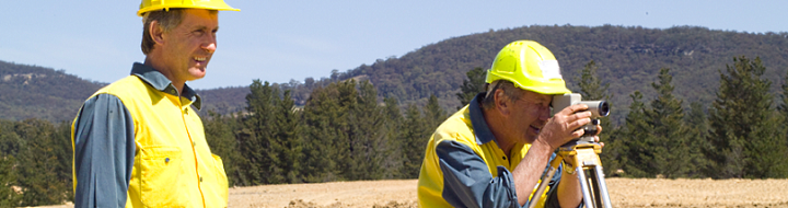 Two land surveyiors in rural area
