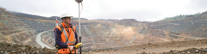 Surveyor in open cut mine