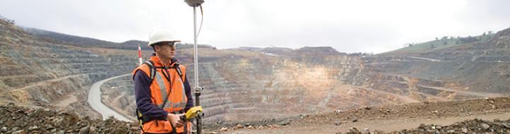 Surveyor in open cut mine